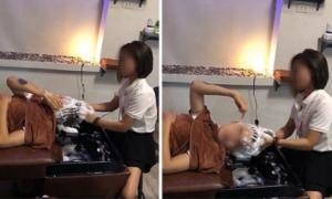 Điên tiết vì bị yêu cầu quá nhiều, nhân viên gội đầu thẳng tay tát bốp vào mặt khách hàng