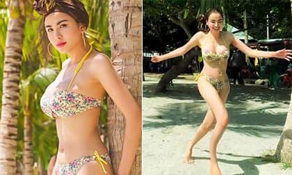 Hoa hậu Diễm Hương đăng ảnh bikini phô vòng một phồn thực