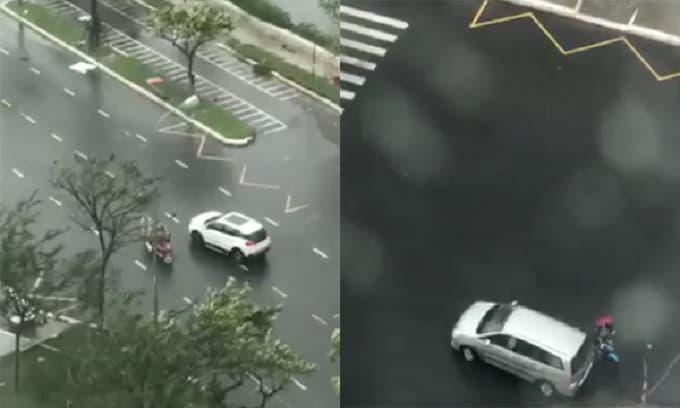 Bất chấp nguy hiểm ra đường trước bão số 9, người đi xe máy phải nhờ ô tô dìu để quay đầu