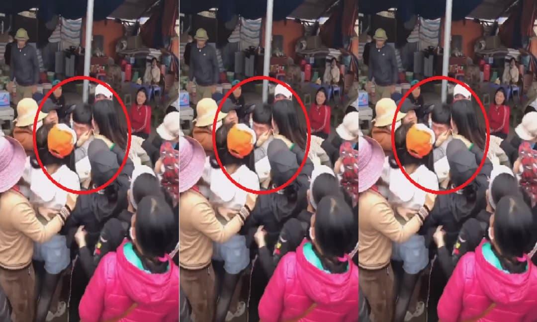 Nam thanh niên bị hàng chục chị em phụ nữ vây quanh đòi ôm hôn giữa chợ khiến dân tình xôn xao