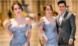 Quỳnh Nga mặc váy xẻ sâu khoe vòng một táo bạo bên Việt Anh sau khi công khai nâng ngực