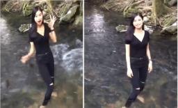 Mặc kệ biển báo cấm, gái xinh lội xuống suối cá thần ở Thanh Hóa gây tranh cãi