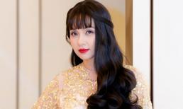 'Nữ hoàng ảnh lịch' Việt Trinh trẻ ra cả chục tuổi với tóc dài chấm hông