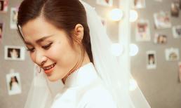 Chỉ một chiếc áo dài trắng, Đông Nhi trở thành cô dâu tinh khôi nhất với nhan sắc dịu dàng xao xuyến