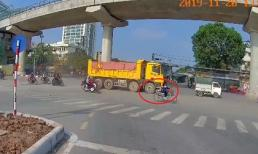 Rơi vào điểm mù xe ben, cặp đôi chạy xe máy bị cán thương tâm trên phố ở Hà Nội