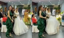 Đi ngang qua đám cưới, ca sĩ Thủy Tiên liền nán chân ở lại chụp ảnh với cô dâu chú rể và gửi lời chúc phúc