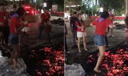 Dân mạng tranh cãi về hình ảnh cô gái đi chân trần bước qua than đỏ vì được bạn bè thử thách