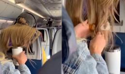 Đi chung chuyến bay, bị người đằng trước xõa tóc che màn hình, cô gái bôi kẹo cao su lên tóc để trả đũa