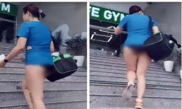 Bà mẹ 'thả rông' vòng một dạo chơi khắp Sài Gòn lại gây sốc khi mặc quần chip đến phòng tập gym