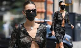 Siêu mẫu Bella Hadid phanh gần hết vạt áo lấp ló vòng một không nội y