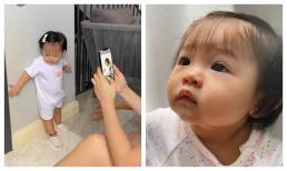 Con gái Cường Đô La mới một tuổi mà tạo dáng như model, lộ hậu trường chụp ảnh 'cưng xỉu'