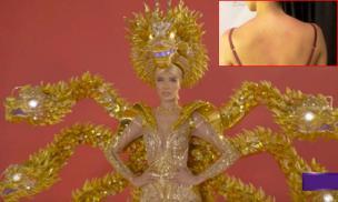 Hoàng Thùy tung clip tiết lộ vai và lưng bị thương khi diện quốc phục nặng 30kg
