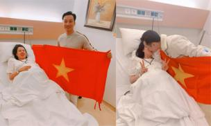 MC Thành Trung mang cờ Việt Nam vào bệnh viện vừa chúc mừng U22 Việt Nam vừa đợi vợ sinh