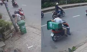 Người đàn ông thản nhiên trộm thùng rác giữa chốn đông người gây bức xúc