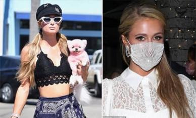 Paris Hilton để mặt 'tơ hơ' ôm cún cưng dạo phố sau khi bị chỉ trích vì đeo khẩu trang lưới đi hẹn hò với trai