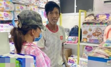 Khoảnh khắc người chồng đang bám đầy bụi bẩn dẫn vợ bầu đi mua thuốc bổ khiến dân mạng xúc động