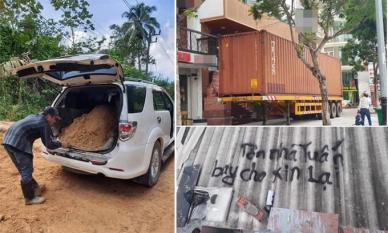 Muôn kiểu chống bão số 9 của người dân miền Trung: Mang xe container án ngữ trước nhà, đổ đất vào ô tô để tránh gió thổi lật