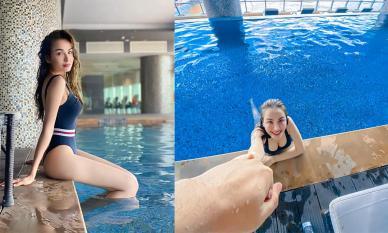 Diễm Hương đăng ảnh bikini nóng bỏng nhưng dân tình chỉ chú ý đến bàn tay người đàn ông nắm tay nàng Hậu