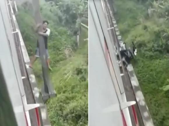 thoát chết trong gang tấc, tránh tàu hỏa